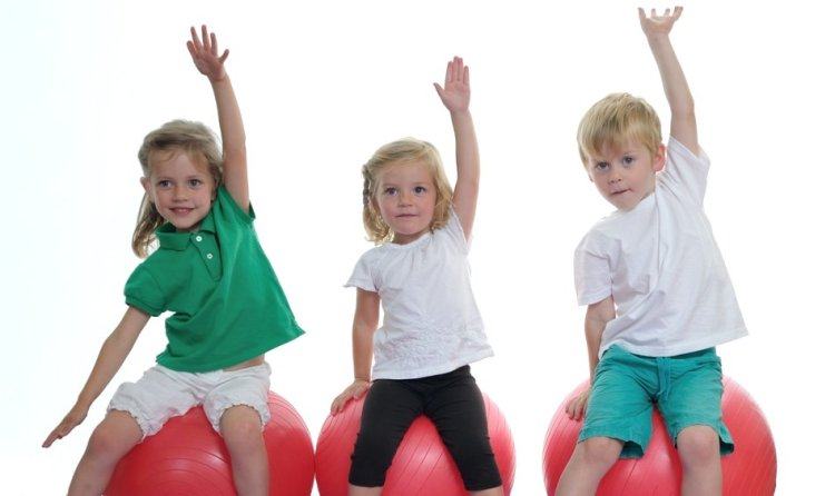 kids on exercise balls